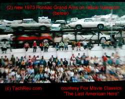 The train passes loaded with cars including two 1973 Grand Am's: (1) White and followed by (1) Silver with Burgundy Vinyl Roof. Estimate is that the train was moving about 45mph in the background, hence the poor quality of the car image(s). Image(s) Courtesy Fox Movie Classics.