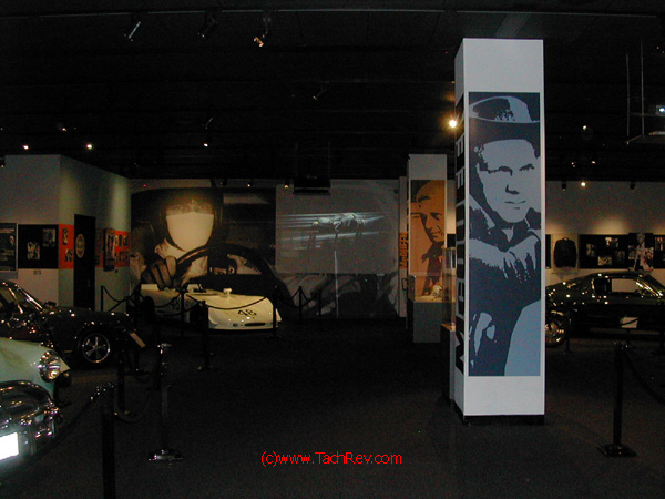 My entrance into the Steve McQueen exhibit garnered this eye candy: Steve driving in the Movie Le Mans on the back wall with his racecar below, the Mustang from the movie BULLET, other cars he owned and the many movie images of Steve McQueen.
