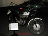 Close-up of one Steve McQueen's motorcycles - this one a Triumph - on display.