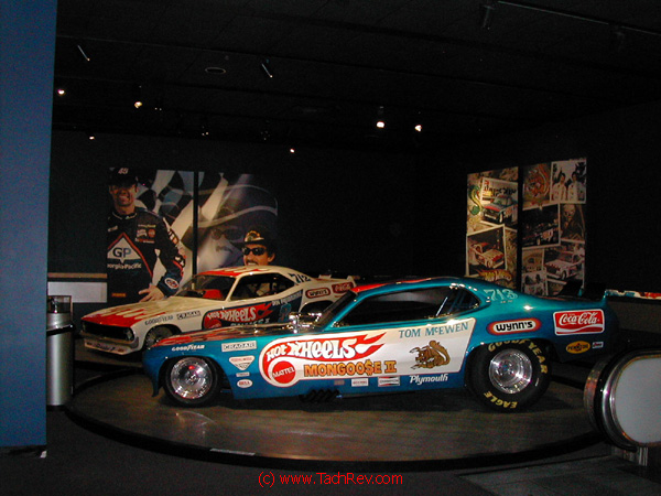 Don Prudhomme's The Snake II and Tom Mc EWEN 's The Mongoose II NHRA Top-Fuel Funny Cars display.