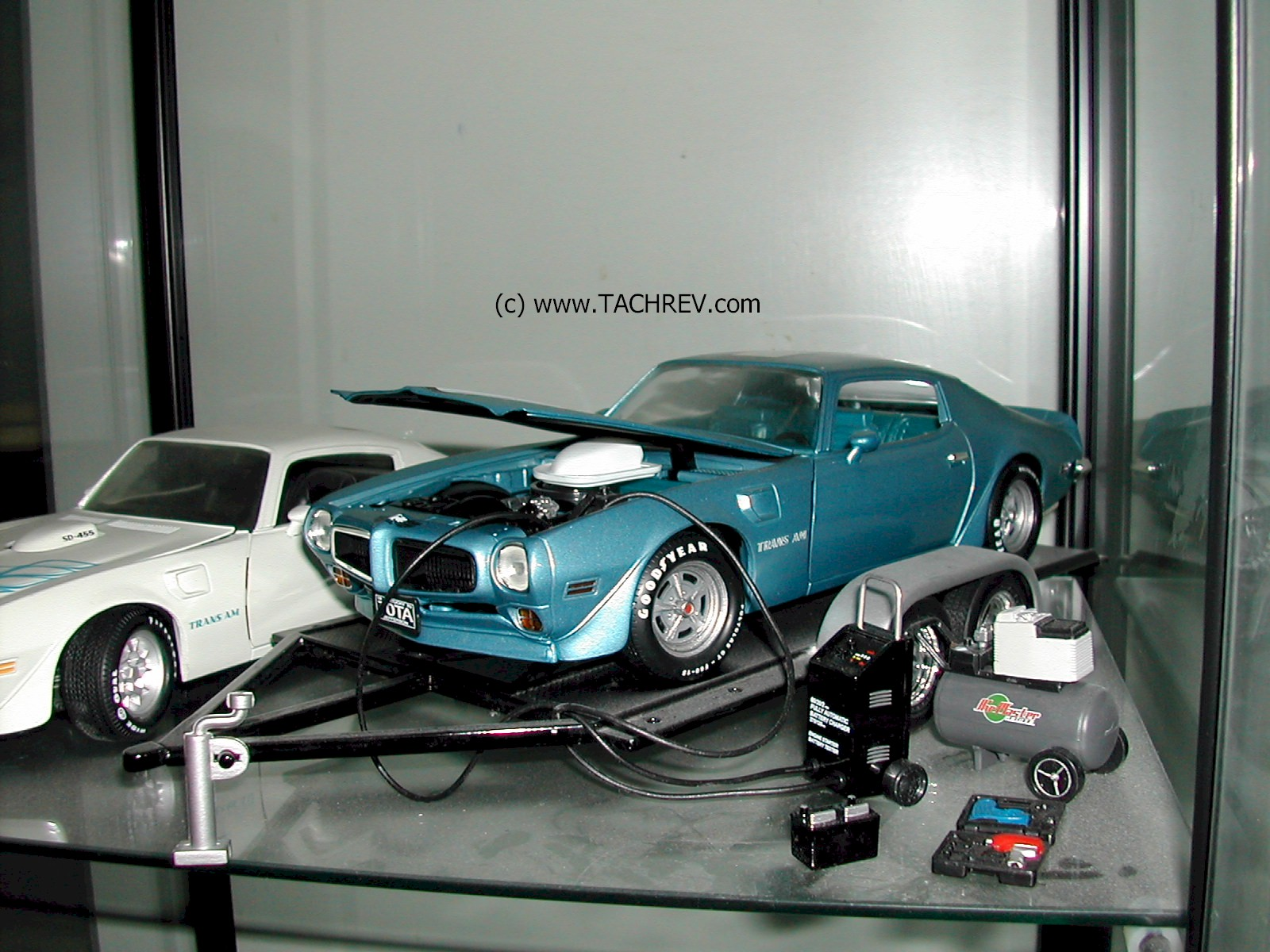 Getting the old T/A ready for the show in small scale.  The usual dead battery syndrome of the collector car in storage.